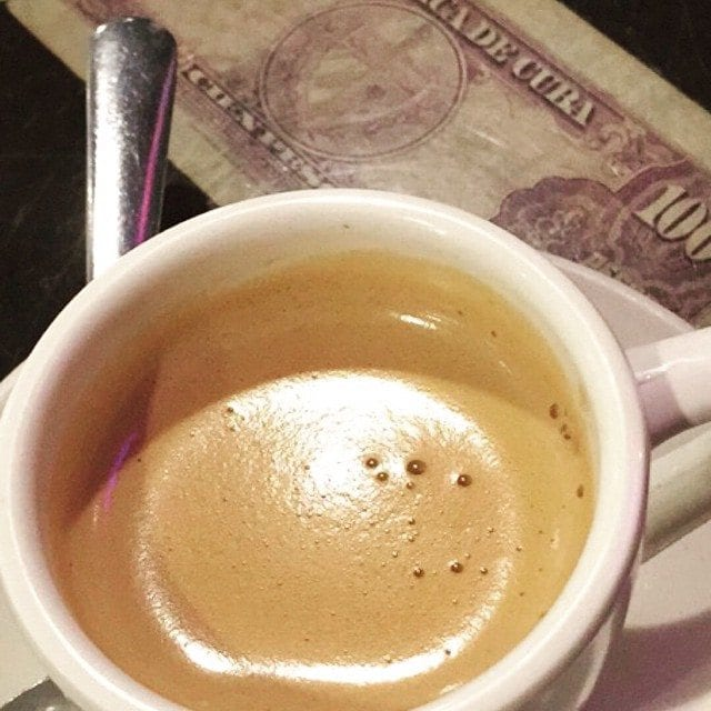 cuban coffee with cuban currency / money.