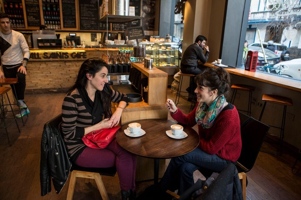 Customers meeting up over a cup of coffee at All Saints Café