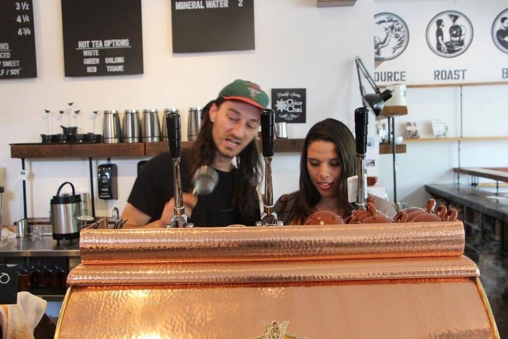 Baristas behind the coffee machine