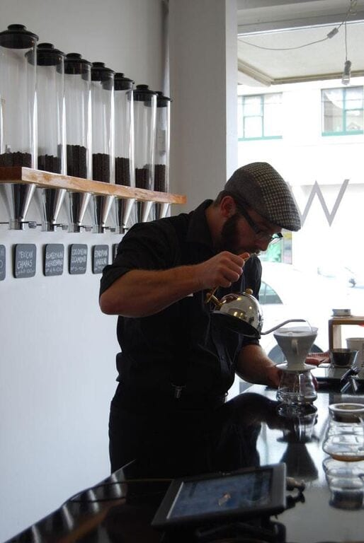 Barista making a V60 coffee