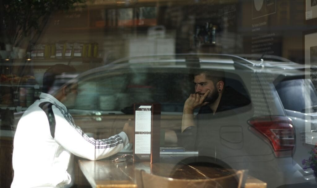 men in a café
