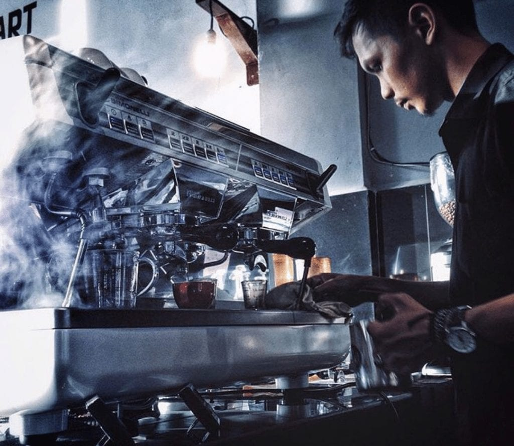 barista working at an espresso machine