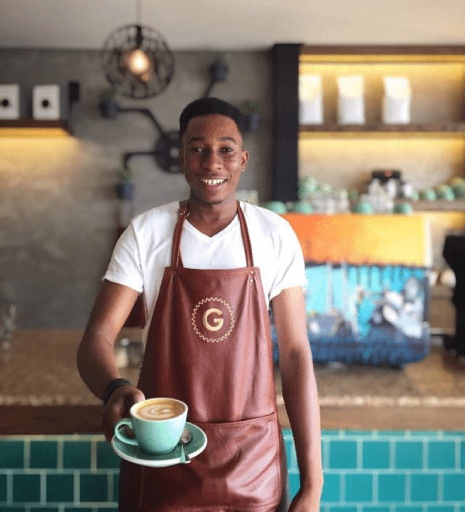 barista serving a coffee