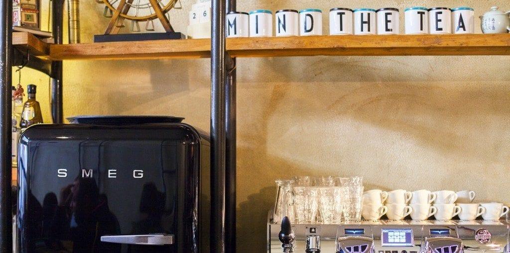 smeg fridge and tea cups
