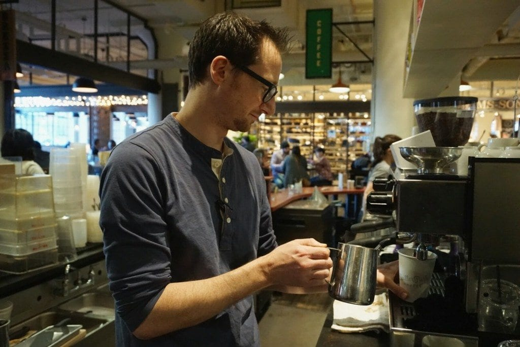barista frothing milk