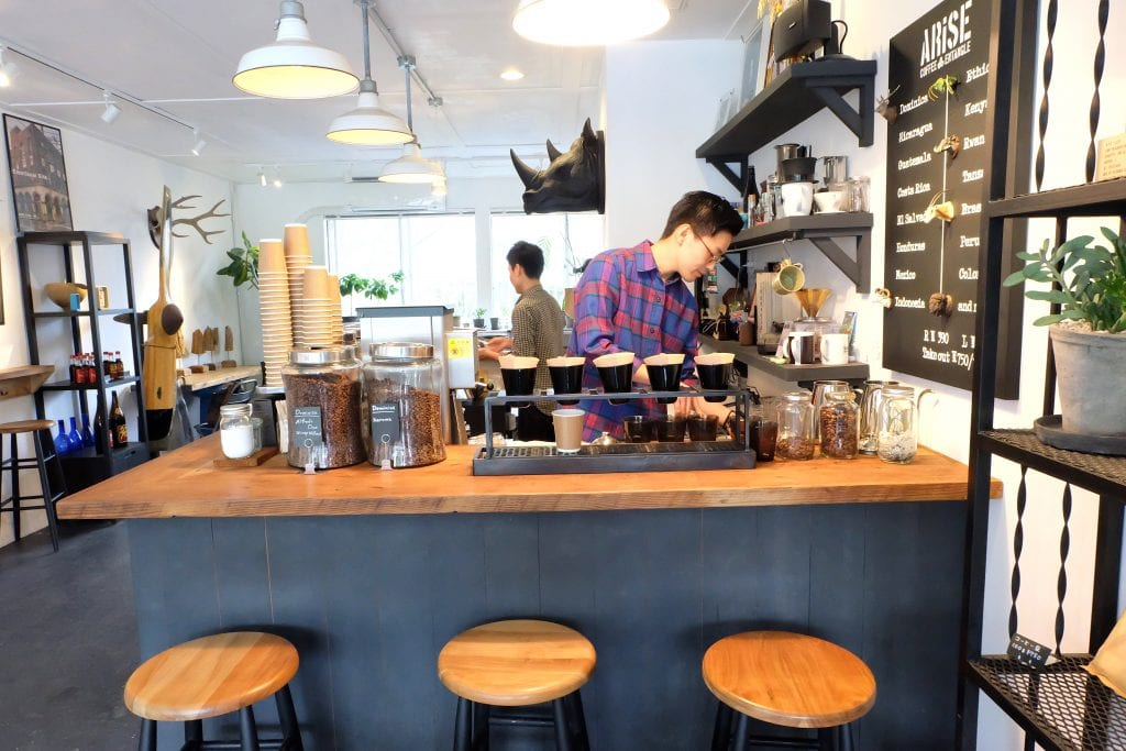 barista at work at arise coffee shop