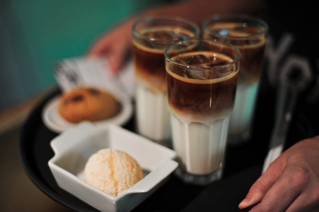 Iced lattes and ice cream being served