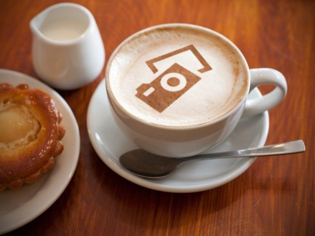 camera latte art on cappuccino