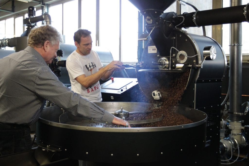 roasted coffee being released from the roaster