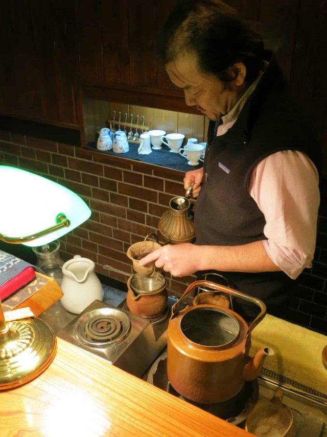 Mr. Fujiwara pouring into a nel drip