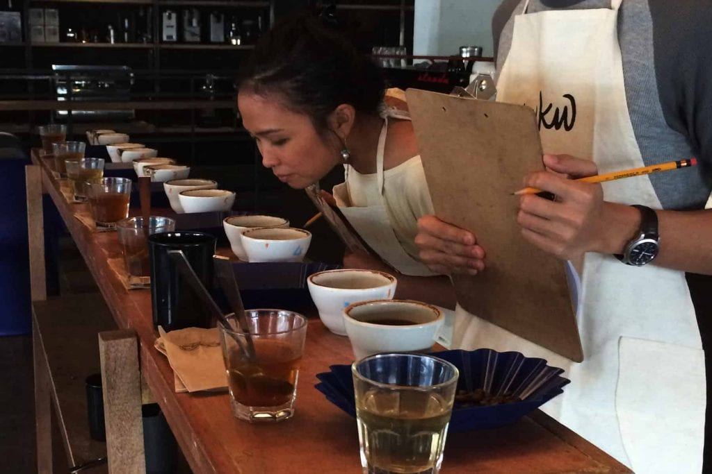 A woman cupping specialty coffee