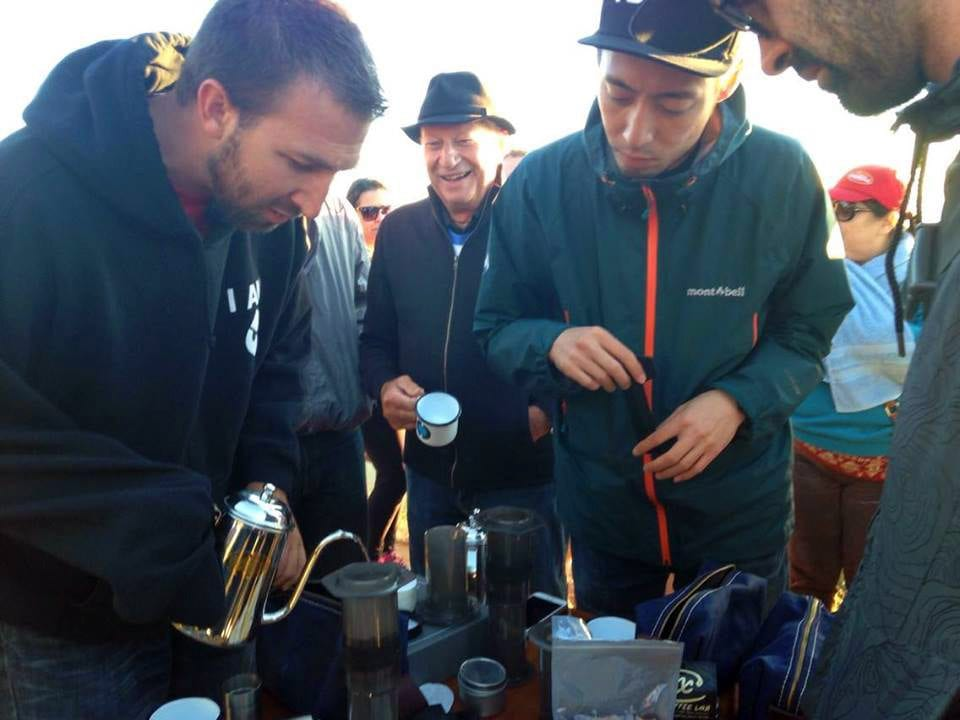 Tetsu Kasuya and Todd Goldsworthy making AeroPress coffee on the top of Pica de Bandeira