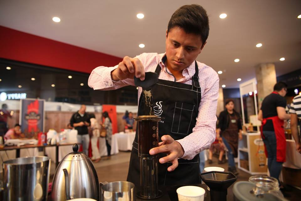 Jorge Luis Tuquinga stirs his AeroPress coffee