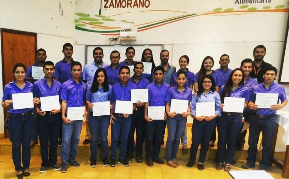 Zamorano students hold their certificates
