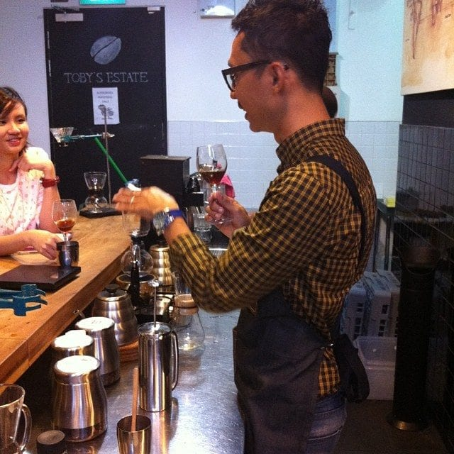barista behind bar