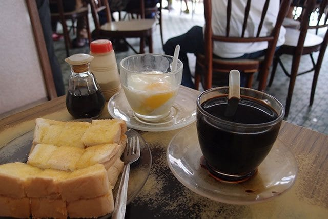 Kopi, soft boiled eggs, bread, and jam