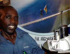 Amon Masaya serves coffee overlooking the Muturazi Falls in Honde Valley