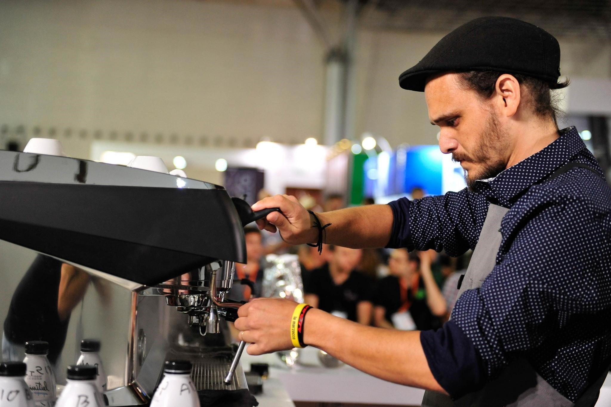 Alex Pereira Santos pulls an espresso shot