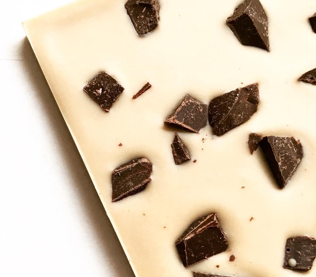 Tahini white chocolate bar with dark chocolate chunks.