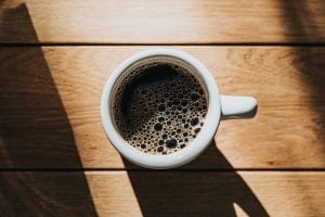 freshly brewed black coffee in coffee cup
