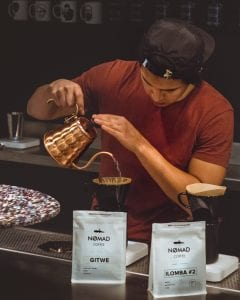 barista brewing coffee in v60
