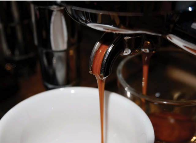 Espresso flowing into cup