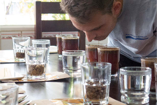 man at coffee cupping table