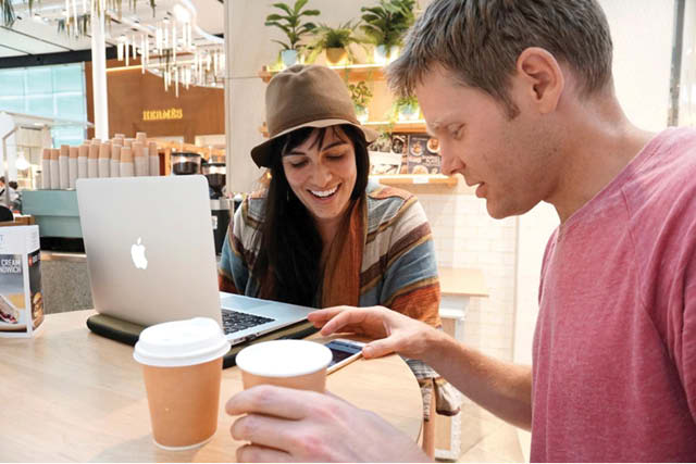 man and woman in a coffee shop