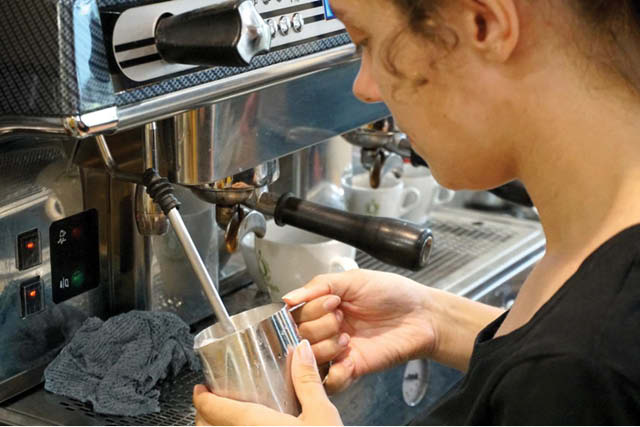barista steaming milk