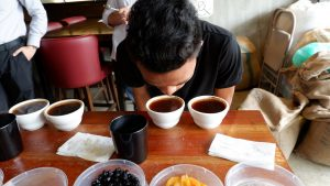 man cupping coffee