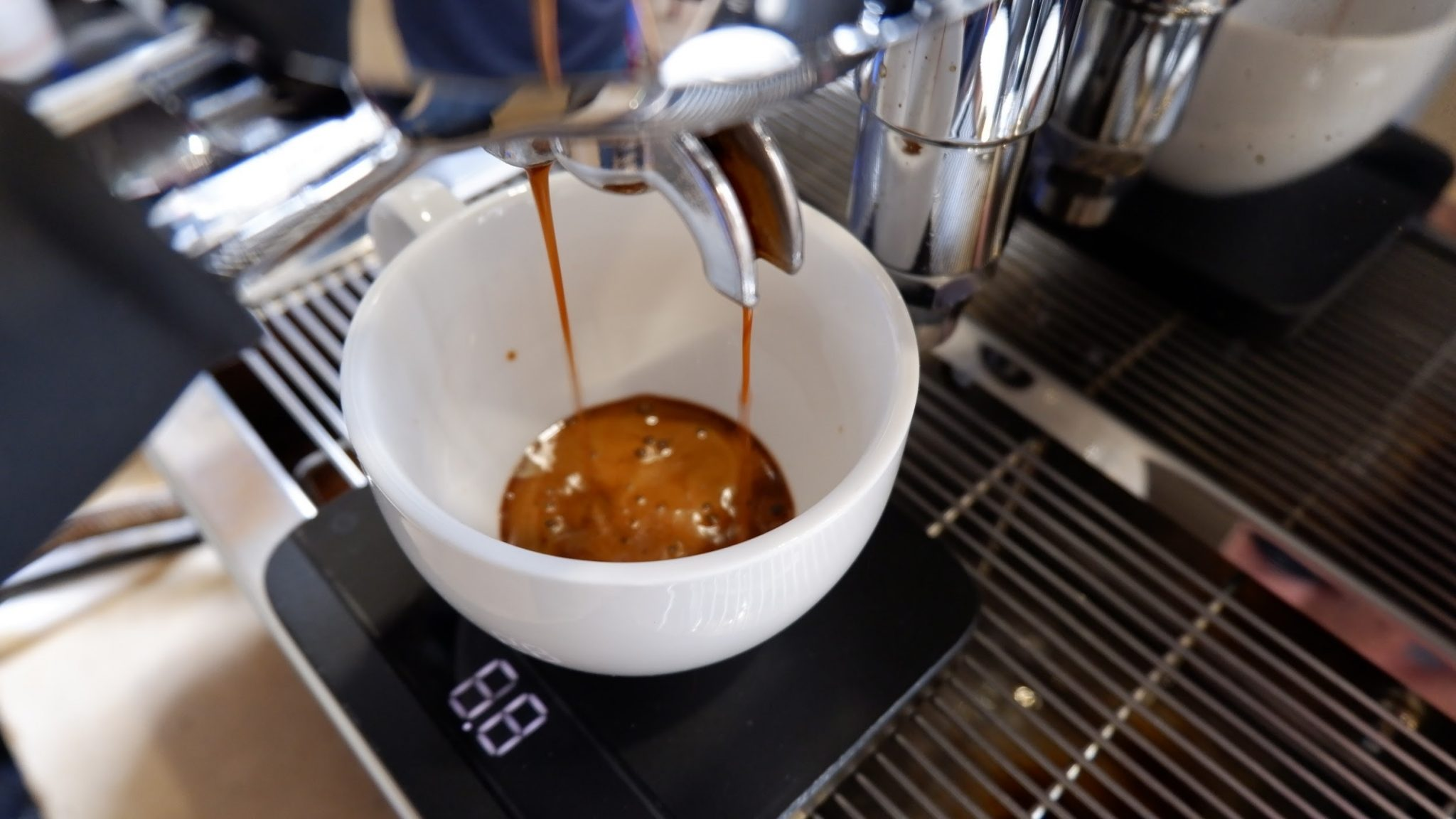an espresso machine in action in a coffee shop