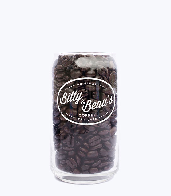 A Bitty and Beau's glass filled with coffee beans