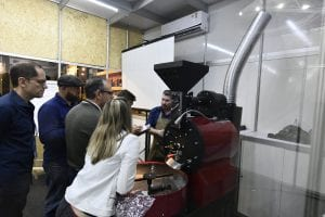 Attendees learning about roasting arabica and robusta coffees