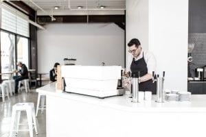 barista behind espresso machine