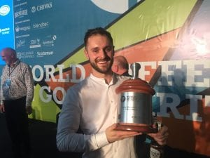 World Coffee in Good Spirits Champion Dan Fellows with his trophy