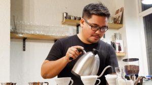 barista brewing coffee on V60
