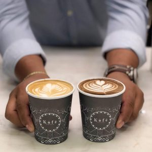 latte and hot chocolate with latte art