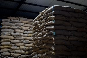 coffee bags stacked in warehouse