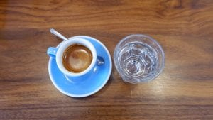 shot of espresso and a glass of water