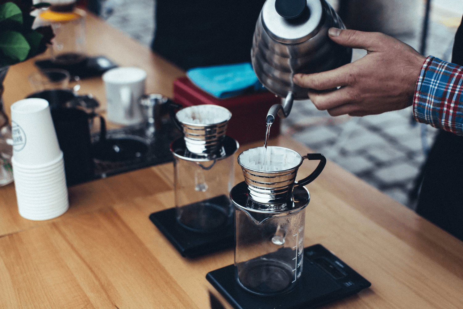 A barista brews two kalita wave