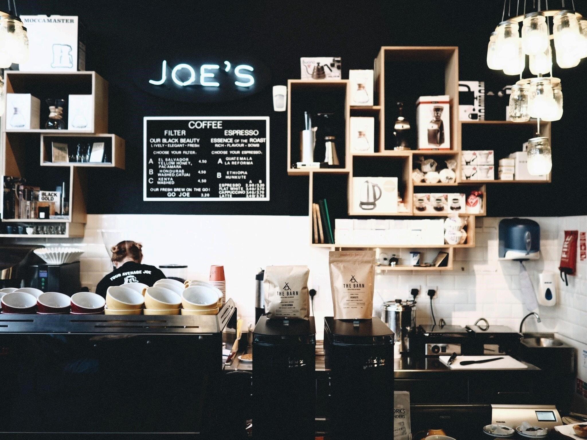 a barista behind the coffee bar
