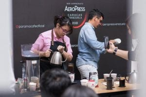 barista brewing coffee on aeropress
