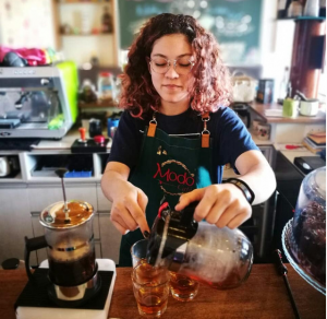 barista pouring a coffee infusion