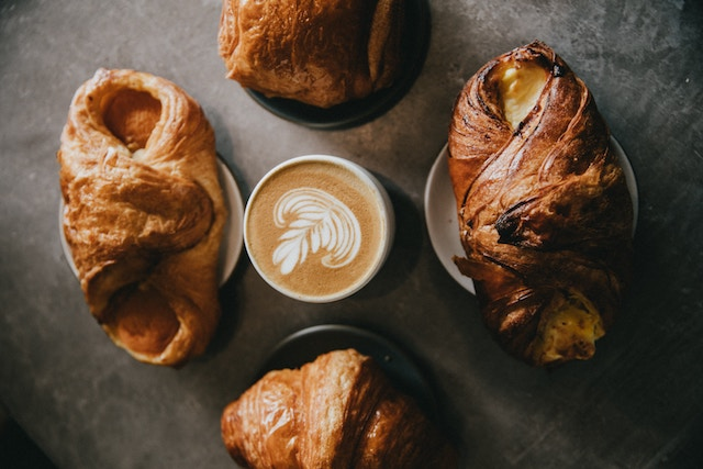 pastries and milk based coffee drink served