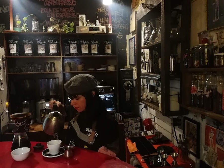 A barista brews an amazing single origen coffee
