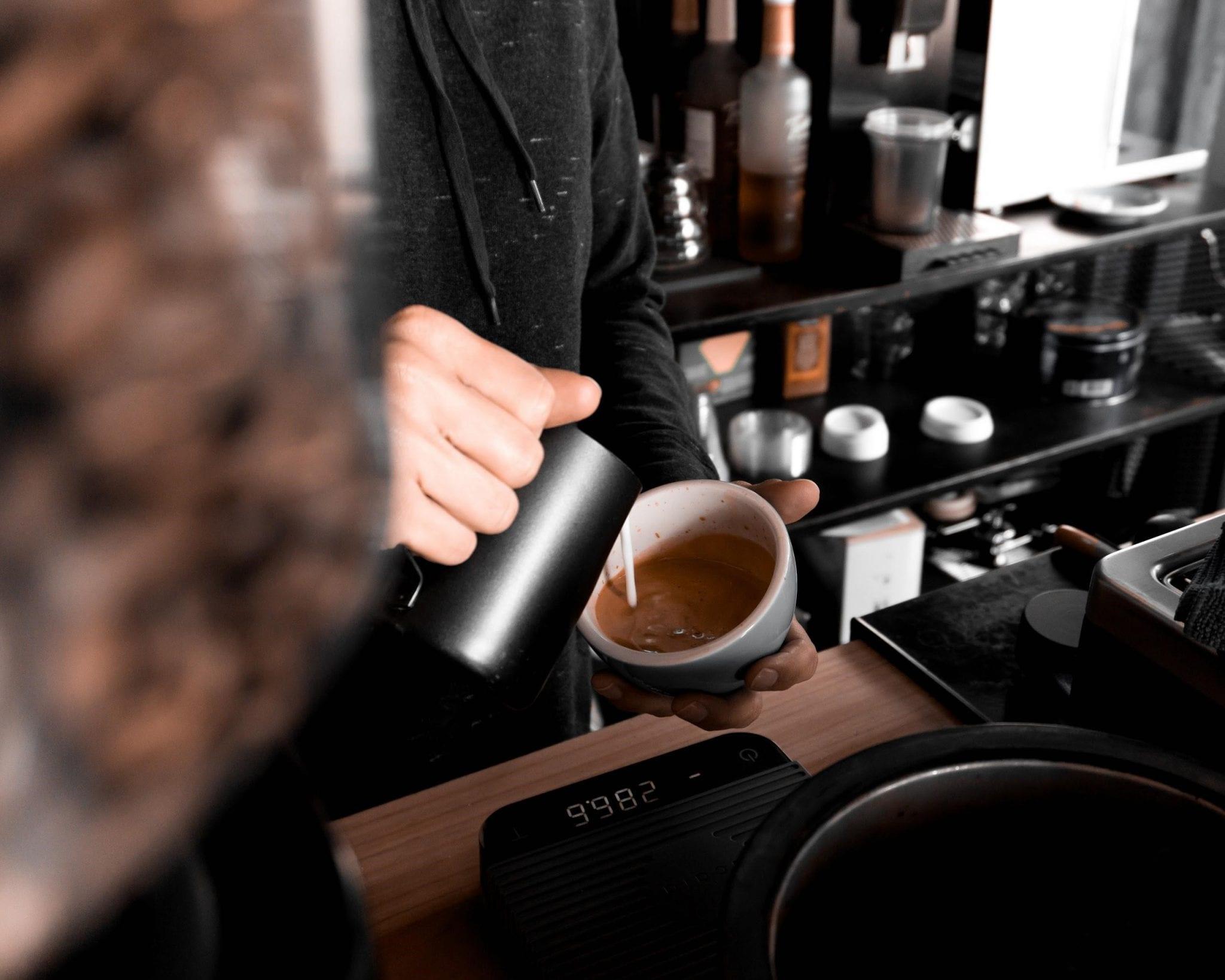 Barista prepares a cappuccino