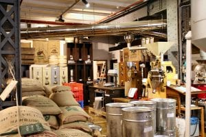 green coffee bags stored at roastery