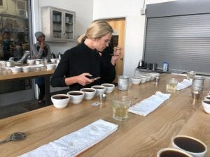 woman cupping coffees