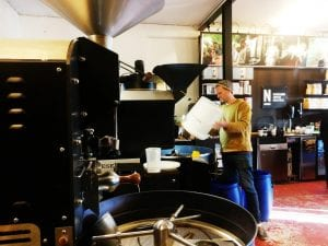 coffee roaster in his roastery