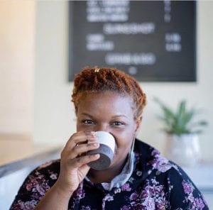 Cyndi Patterson, barista, drinking coffee